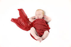 Newborn baby boy with red wrap royalty free stock image