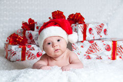 Newborn baby boy Santa Claus with Christmas gifts Stock Photos
