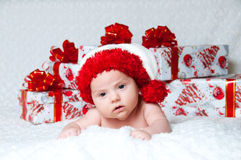 Newborn baby boy Santa Claus with Christmas gifts Stock Photo