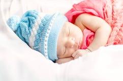 Newborn baby boy sleeping in basket Royalty Free Stock Photography