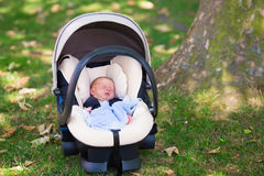 Newborn baby boy sleeping in car seat royalty free stock photo