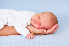 Newborn baby boy sleeping on the hand of his father Royalty Free Stock Image