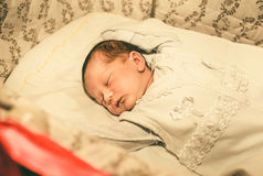 The newborn baby boy sleeping in his bed Royalty Free Stock Photography