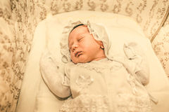 The newborn baby boy sleeping in his bed Royalty Free Stock Photo