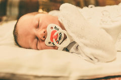 The newborn baby boy sleeping in his bed Royalty Free Stock Image