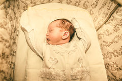 The newborn baby boy sleeping in his bed Royalty Free Stock Images
