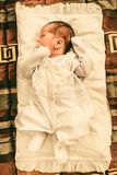 The newborn baby boy sleeping in his bed Stock Photography