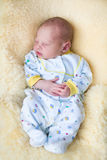 Newborn baby boy sleeping on a sheepskin Royalty Free Stock Image