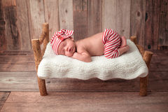 Newborn Baby Boy Sleeping on a Tiny Bed Royalty Free Stock Photography