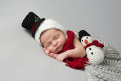 Newborn Baby Boy with Snowman Hat and Plush Toy Royalty Free Stock Images