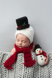 Newborn Baby Boy with Snowman Hat and Plush Toy Stock Photography