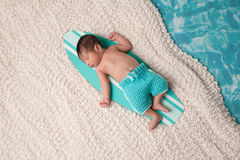 Newborn Baby Boy on Surfboard Royalty Free Stock Image