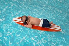 Newborn Baby Boy on Surfboard Royalty Free Stock Photo