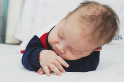 Newborn baby boy two months old sleeping Stock Photos