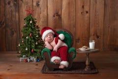 Newborn Baby Boy Wearing A Santa Suit Stock Photo