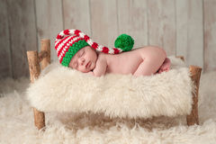 Newborn Baby Boy Wearing a Christmas Elf Hat Royalty Free Stock Photography
