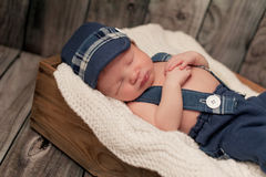 Newborn Baby Boy Wearing a Newsboy Cap and Suspenders Stock Images