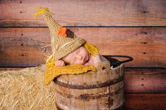 Newborn Baby Boy Wearing Scarecrow Costume Stock Image