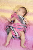 Newborn baby boy wrapped in a pink scarf Royalty Free Stock Image