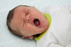 Newborn baby boy yawning Stock Photos