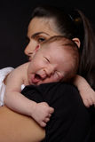Newborn baby boy yawning. 11 days old newborn baby boy yawning on his mom shoulder Royalty Free Stock Photography