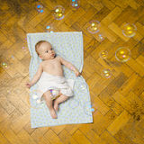 Newborn baby and bubbles royalty free stock photography