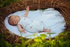 Newborn baby care. Motor activity of newborn baby. Outdoor activity of newborn child. Cheerfulness and health. Boost the. Spirit of cheerfulness. We care stock photo