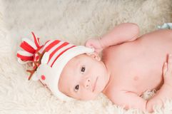 Newborn baby in chritstmas hat Stock Photography