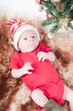 Newborn baby in chritstmas hat Stock Photos