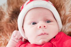 Newborn baby in chritstmas hat Stock Photo