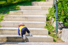 Newborn baby climb stairs step by step Stock Image