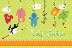 Newborn baby clothes hanging on the rope.Baby fashion set. Colorful clothes for newborn baby boy and girl hanging on the rope on polka dot background. Design Stock Photos