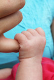 Newborn baby clutching mothers finger Royalty Free Stock Photo