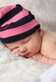 Newborn baby clutching mothers finger Royalty Free Stock Photos