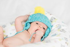 Newborn baby with colorful cap Royalty Free Stock Image