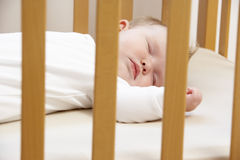 Newborn Baby In Cot Stock Photos