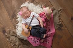 Free Newborn Baby Cowgirl Playing A Tiny Guitar Stock Images - 120858614