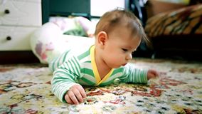Newborn baby crawling on the floor stock footage