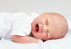 Newborn baby crying because of cramps. Three weeks old royalty free stock image