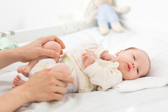 Newborn baby daughter doing hip exercise Stock Photo