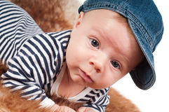 Newborn baby in denim cap Stock Photos