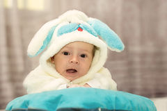 Newborn baby dressed in rabbit suit Royalty Free Stock Photography