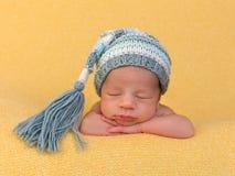 Newborn baby face closeup stock photo