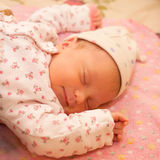 Newborn baby is fast asleep Stock Image