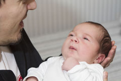 Newborn baby and father Royalty Free Stock Photos