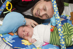 Newborn baby and father Stock Images
