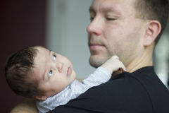 Newborn baby with father Stock Image