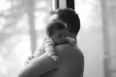 Newborn baby with father Stock Photography