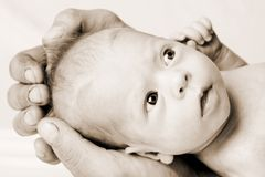Newborn Baby in Father's Hand Stock Photography