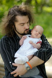 Newborn baby in father's hands. Father is holding his newborn baby in the hands Stock Images